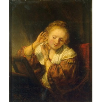 Young Woman with Earrings. By Rembrandt Harmensz. van Rijn